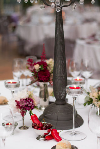 wedding reception table floral decoration in deep red a pearl white
