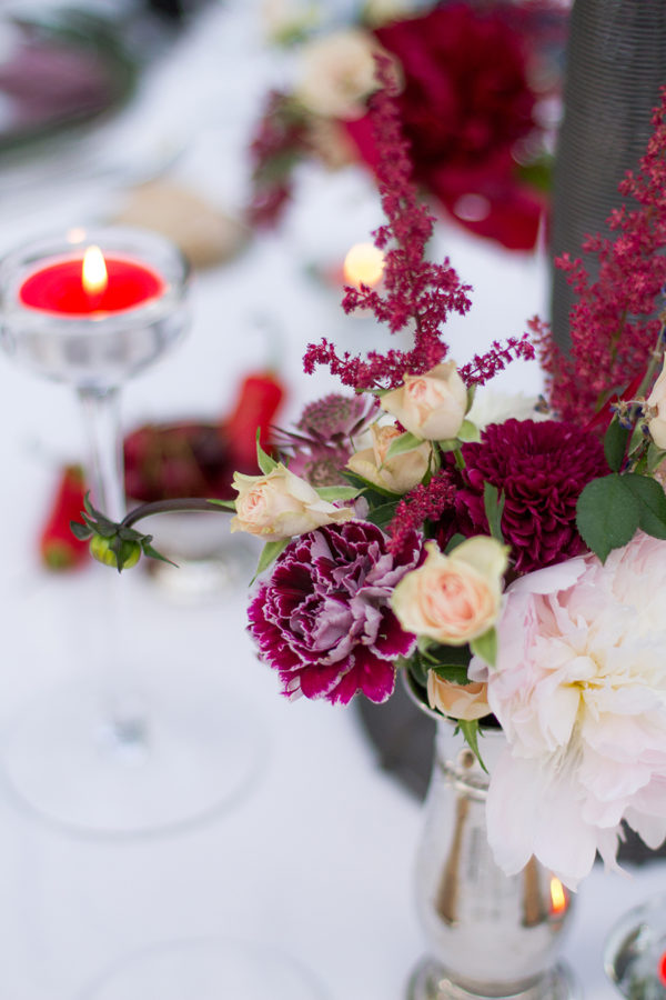 table floral decoration in deep red a pearl white