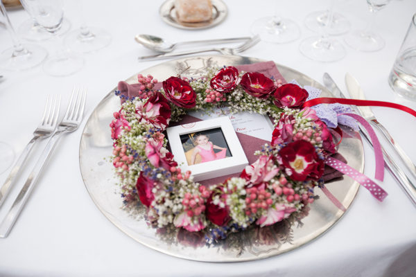 floral headpiece on a reception dinning table setting