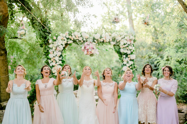 pastel bride and bridesmaids bouquet peonies and roses