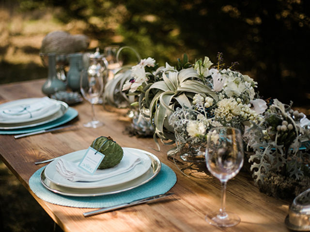 forest green and blue themed wedding reception table